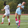 BRYAN EATON/Staff Photo. Abigail Sturim and Triton's Chloe Connors missed on the header.