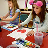 BRYAN EATON/Staff Photo. Savannah Washburn, 7, right uses watercolors to make a heart while Autumn Shamano, 7, fills in a heart with rainbow colors on Wednesday afternoon. They were at the Salisbury Elementary School afterschool program Explorations taking Color and Paint taught by Cindy Krafton.