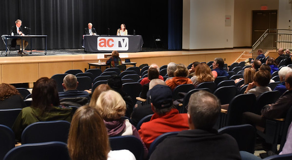 BRYAN EATON/Staff photo. About 100 people turned out to hear debates running for various offices at Amesbury High School on Thursday night.