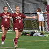BRYAN EATON/Staff photo. Anna Affolter and Isabelle Rosa celebrate Newburyport's third goal.