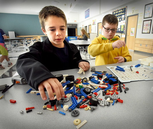 BRYAN EATON/Staff Photo. Legos building started this week at the Salisbury Elementary Schoo's afterschool program Explorations. Dalton Baumann, 9, left, and Gregory Berger, 10, organize the pieces before deciding what creations they want to build.