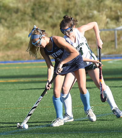 BRYAN EATON/Staff photo. Triton's Mia Gustafson moves the ball away from Meg Arnette.