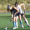 BRYAN EATON/Staff photo. Triton's Mia Gustafson moves the ball away from Meg Arnette.