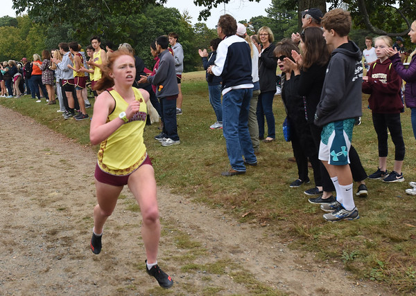 BRYAN EATON/Staff photo. Lucy Gagnon is the first Newburyport runner over the finish line.