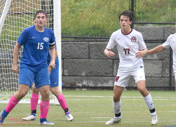 BRYAN EATON/Staff Photo. Newburyport's Brady O'Donnell, right, in action with Georgetown.
