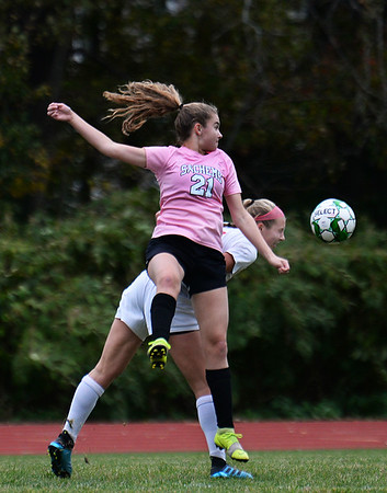 CARL RUSSO/staff photo. Pentucket's Katelyn Sudbay fights to head the ball with Amesbury's Alyssa Pettet  in soccer action. 10/16/2019