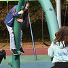 BRYAN EATON/Staff Photo. Lucky for children at the Bresnahan School the earlly morning rain ended allowing them to have outdoor recess. Sawyer Wilson, 9, left and Ruby Wallace, 8, spent some time on the tubular seesaw.