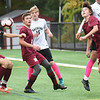 BRYAN EATON/Staff photo. Harry Costello heads the ball away from the Newburyport goal.