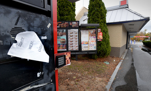 BRYAN EATON/Staff Photo. A sign on the drive-up ordering kiosk at the Amesbury Burger King advises customers they're closed.