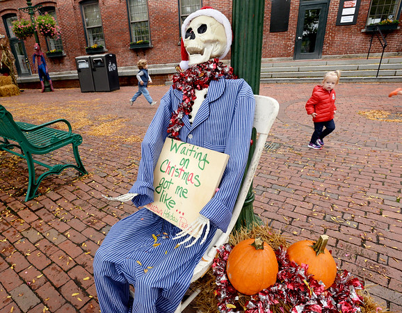 BRYAN EATON/Staff Photo. A scarecrow by the Amesbury Holiday Parade Committee sits in Market Square, one of many in the downtown area. Businesses, individuals and groups have been putting up the scarecrows in a contest sponsored by the Amesbury Chamber of Commerce and Industrial Foundation. People will cast their ballots starting Tuesday October 1 until October 15 with the winners being announced the next day for the different categories.