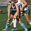 BRYAN EATON/Staff photo. Pentucket's Hannah Babcock tries to move the ball past Triton's Rylee Lucia.