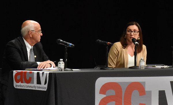 BRYAN EATON/Staff photo. Amesbury Mayor Ken Gray, left, and challenger Kassandra Gove faced each other in a debate after other candidates presented their views Thursday night in the event hosted by the Daily News.