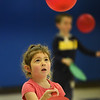 "BRYAN EATON/Staff Photo. Lilianna Sanfacon, 5, uses a ping pong paddle to strike a balloon in Margaret Welch's physical education class at Amesbury Elementary School. Once a week the kindergartners do a ""striking"" excercise which helps with their eye to hand coordination."