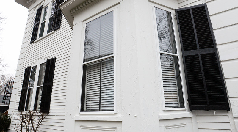 BRYAN EATON/Staff Photo. The owner of this condo unit on Park Street in Newburyport has run into a roadblock with the city on trying to replace the inside windows, seen through the storm windows.