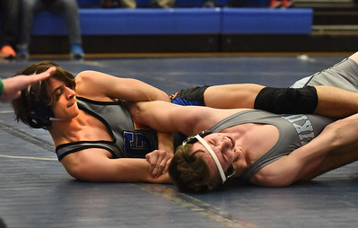 BRYAN EATON/Staff photo. Georgetown/Ipswich's Troy Forgitano in a match with Triton's Dylan Karpenko in the 132 pound class.