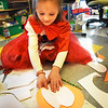 BRYAN EATON/Staff Photo. Dressed as LIttle Red Riding Hood, Kiley Forrest, 6, learns to make a Valentine Card in Robin O'Malley's kindergarten class at the Bresnahan School in Newburyport. The students were dressed in costumes and playing different games for mid-Winter fun and making the cards for the holiday in two weeks.