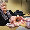 BRYAN EATON/Staff Photo. Christine Raimo of Amesbury crochets a blanket for a toddler at the Blankets For Kids group that meets on Tuesdays at the Amesbury Senior Center. The blankets go to different organizations that see that they get to those in need. The group is glad to accept donations of materials which can be dropped off at the center.