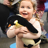 BRYAN EATON/Staff Photo. Ivy Cox, 3, shows her excitement holding a stuffed penguin at the Joppa Flats Education Center. She was at the Imagine, Sing and Learn series, for youngsters from 3-6 years-old, this one on Penguins of the South presented by Lisa Hutchings, Joppa Flats School and Youth Education Coordinator. Children learned about the flighless birds and how they survive in cold climates.