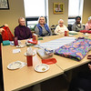 BRYAN EATON/Staff Photo. The Blankets For Kids group that meets on Tuesdays at the Amesbury Senior Center held a belated Christmas party as they were snowed out last month for their planned gathering. The blankets go to different organizations that see that they get to those in need. The group is glad to accept donations of materials which can be dropped off at the center.