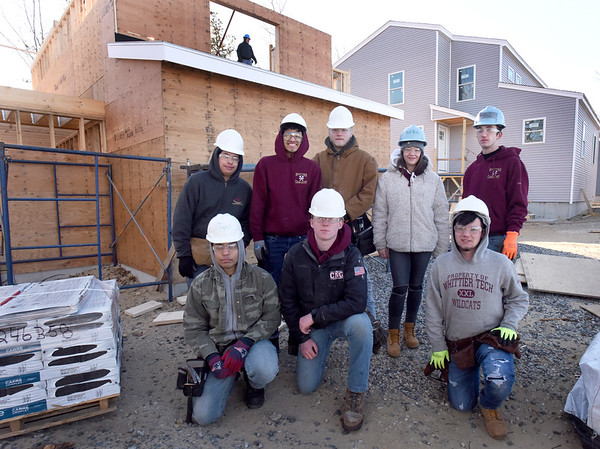 BRYAN EATON/Staff Photo. Whitter Tech carpentry students working on homes for Habitat For Humanity in Salisbury, front, from left, Tyler Wetherbee, Ethan Burridge and Cody LIttlefield. Back, from left, Angel Alvarado, Jyrell Ruiz, Jacob Goodhue, Siarra Cronin and Aristotle Campbell.