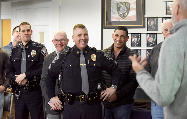 BRYAN EATON/Staff Photo. Former and active police, friends and family gathered to see Amesbury Police Sgt. Rick Poulin, center, on his last day of duty as he's retiring.