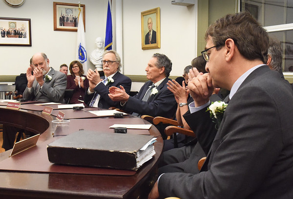 BRYAN EATON/Staff Photo. Jared Eigerman, right, is applauded by fellow council members as he was elected president.