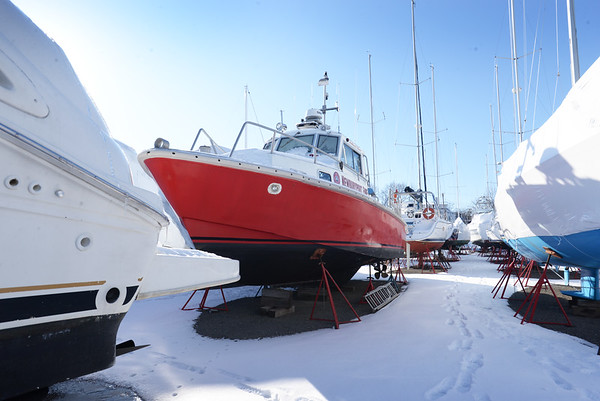 BRYAN EATON/Staff Photo. The Newburyport Fire Department boat Raven is being stored at the Windward Yacht Yard.
