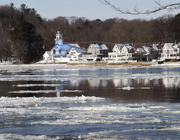BRYAN EATON/Staff Photo. The Union Congregational Church and other homes along Amesbury's Point Shore reflect on the Merrimack RIver among the ice floes which are becoming more numerous as the temperatures have been colder.