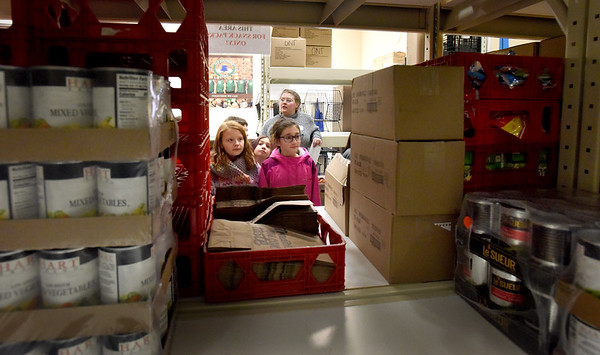 BRYAN EATON/Staff Photo. Student council members check out Our Neighbors Table warehouse on a tour of the Amesbury facility.