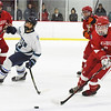 BRYAN EATON/Staff photo. Amesbury's Owen Reid gets the puck past Triton forward Ryan Lindholm.