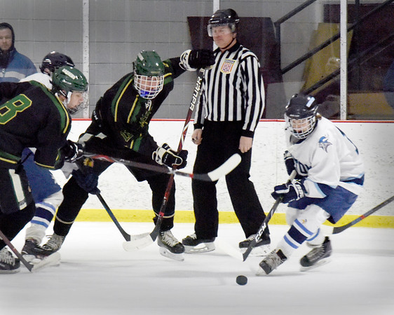 BRYAN EATON/Staff photo. Triton's Benjamin Rennick moves for control of the puck on Pentucket ice.