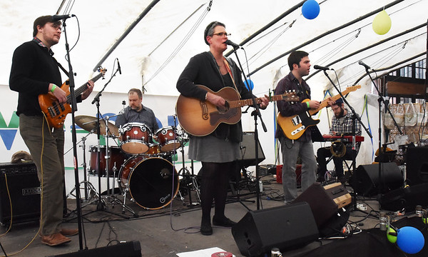 BRYAN EATON/Staff photo. Liz Frame and the Kickers perform at the WE=NBPT Winter Festival on Saturday, one of the bands on the list for the third annual event held at the Tannery Marketplace. The family-friendly event showcases Newburyport from beers, bands to food and artists.