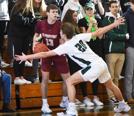 BRYAN EATON/Staff Photo. Jacob Robertson looks for an opening as Pentucket's Sam Stys covers.