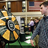 BRYAN EATON/Staff Photo. Jacob Cole, 15, spins the Institutionf For Savings' Trivia Wheel whiched posed questions about the bank and financial ones too. He was at the Vocational Job Fair at Triton Regional High School.