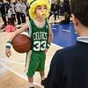 BRYAN EATON/Staff Photo. The Immaculate Conception School in Newburyport held a Wax Museum on Wednesday, part of Catholic Schools Week, where students researched historical figures and dressed the part as the parents and other students checked out the results. Sports fan Louie Mcmanus, 8, took on the persona of Celtics great Larry Bird, though the original was slighly taller.