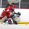 BRYAN EATON/Staff photo. Amesbury defensman Seth Burdick and Jack Sorensen collide going for the puck.