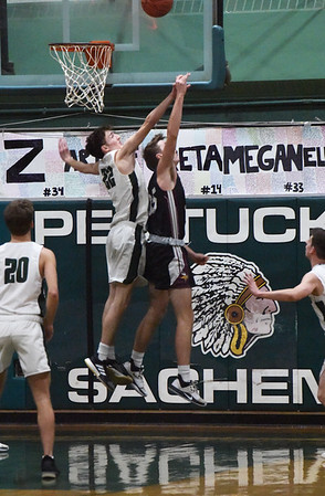 BRYAN EATON/Staff photo. Pentucket's Kenny Lee and Rockport's Gavyn Hillier go airborne as Hillier get the two points and is fouled.