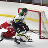 BRYAN EATON/Staff photo. Pentucket's Richie Hardy gets the puck past Amesbury goalie Tre Marcotte.