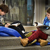 BRYAN EATON/Staff Photo. Thursday was a good day to relax on some bean bag chairs and get in some reading as Alex Estabrook, 10, left, and Colby Tetreault, 9, did in the library at Amesbury Elementary School. The fourth-graders come in once a week to choose two books to take home after librarian Peg Crissinger reads them a story. If they have time left after choosing their books, they settle in to start reading.