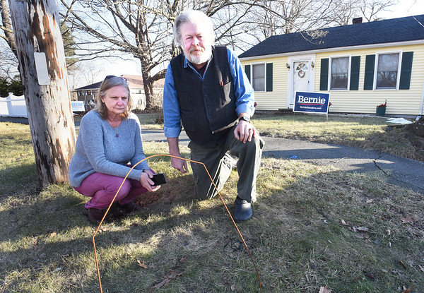 BRYAN EATON/Staff Photo. Audrey and John Proctor wonder why the Bernie Sanders sign was removed from the front of their Macy Street, Amesbury home was removed, but the wire frame left behind.