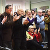 BRYAN EATON/Staff photo. Former Amesbury mayors and others applaud after Kassandra Gove took the oath of office, from left, Thatcher Kezer, #3; David Hildt, #2 and Nicholas Costello, #1.