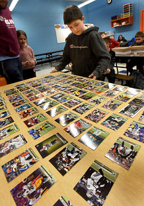 BRYAN EATON/Staff Photo. Zander Gariepy, 10, picked the winning  ticket and was the first to choose from this week's meeting of the Sports Card Club at the Boys and Girls Club, choosing NFL player DeaSean Hamilton of the Denver Broncos. The club teaches them how to properly collect cards, protect them, learn about values and they actually trade with each other.