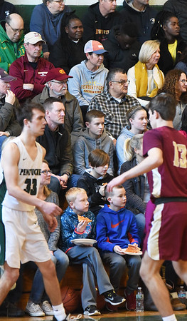 BRYAN EATON/Staff Photo. With schools out and many businesses closed for Martin Luther King Day, the gymnasium at Pentucket High was packed with spectators as they hosted Newburyport boys basketball team. The Clippers won the match 81-63.