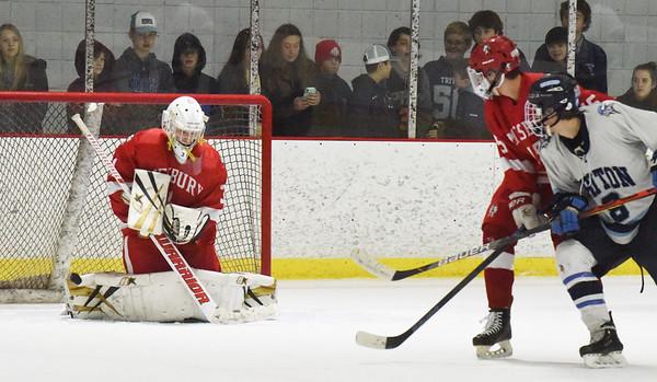 BRYAN EATON/Staff photo. Amesbury goalie Tre Marcotte deflects a shot by Jack Hiska.