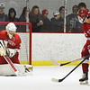 BRYAN EATON/Staff photo. Amesbury goalie Tre Marcotte deflects a shot by Jack Hiska.