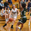 BRYAN EATON/Staff photo. Triton'sCaitlin White moves in to score two points.