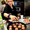 BRYAN EATON/Staff photo. Brianna Dow, 14, readies the meatballs she made for frying and finishing in the oven at this week's cooking class at the Boys and Girls Club in Salisbury. This week's theme was food for the Superbowl in which the young chefs also made sloppy joes, crab rangoons, maple-glazed chicken wings, cooked apple wraps and banana chocolate chip cookies.