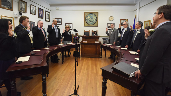 BRYAN EATON/Staff Photo. Newburyport city councilors were sworn in last night, from left, Afroz Khan, Joseph Devlin, Byron Lane, Sharif Zeid, Christine Wallace, Barry Connell, Charles Tontar, Bruce Vogel, (Heather Shand and James McCauley, out of view), and Jared Eigerman.l