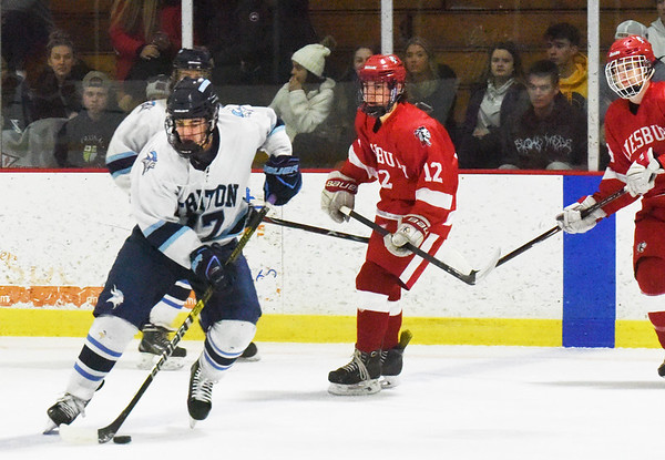 BRYAN EATON/Staff photo. Triton's Ryan Lindholm guides the puck away from Amesbury defenders.