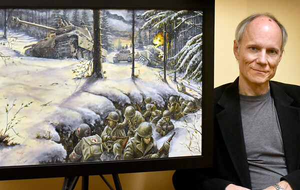 BRYAN EATON/Staff Photo. Artist Rob Brun with his painting of a scene from the Battle of the Bulge.